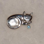 Here is a cute little Cat pin with a small Electric Blue Topaz.