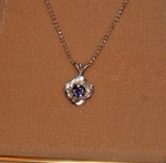 This sterling silver rose pendant is set with a stunning 10pt Sapphire.
