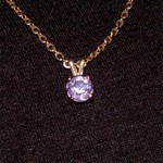 A brilliant Amethyst pendant set in 14K yellow gold.